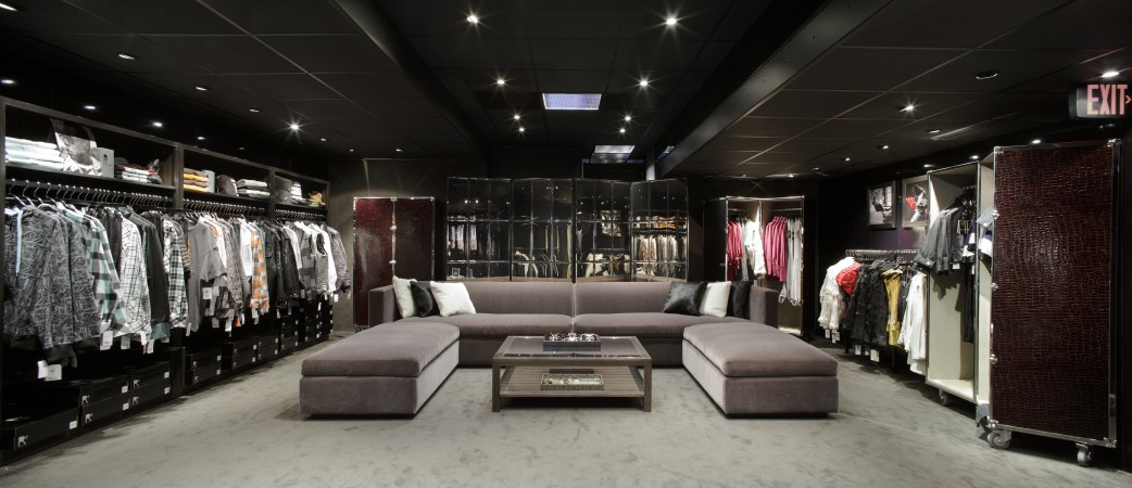 At JayZ's Rocawear pop up shop a luxe lounge with the focus being this large sofa covered in rich mohair with a backdrop of a smoked mirror screen that conceals dressing rooms beyond.