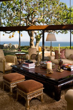 Dramatically set on a steep bluff overlooking the Pacific Ocean in Malibu, Ca. this spectacular home was the former Johnny Carson estate. It has soaring beams and walls of glass; perfect for the homeowner's art collection. The classic look is comfortable yet very sophisticated. The contrast of the light from outside and the dark sumptuous velvets and upholstered pieces inside, creates an intimate and dramatic setting.