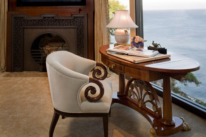 The height of luxury is being able to sit at a mahogany writing table,  in an antique chair, overlooking dramatic and endless views of the Pacific Ocean