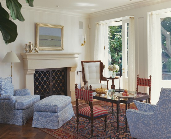 In a sunroom, in a Pacific Palisades home, with an English Regency game table. Melrose House Chippendale chair covered in Blue Silk Velvet.  Chandelier designed by Lois and Paul Ferrante.
