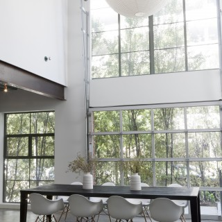 tasting kitchen with large double height windows white modern lightfilled
