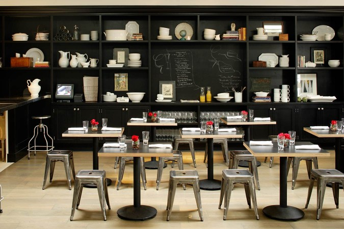 The black painted open shelf display at restaurant Comme a where award- winning chef David