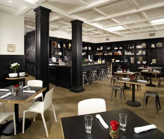 At Comme Ça in West Hollywood the look is created through a minimalist color palette, with black wainscoting, and white furnishings. The mixed vintage French bistro furniture creates a sophisticated but relaxed atmosphere.