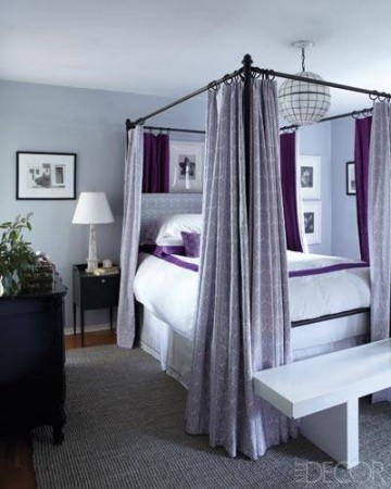 A custom canopy bed in the master bedroom creates a quiet oasis in tones of lavender and purple.
