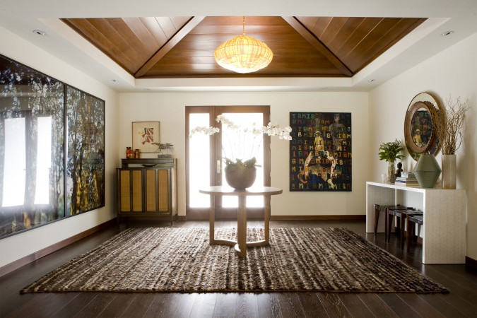To create the look and feel of a Balinese pavilion, the original ceilings were blown out to reveal the peak underneath, which were then covered in a Douglas fir stained to resemble teak.
