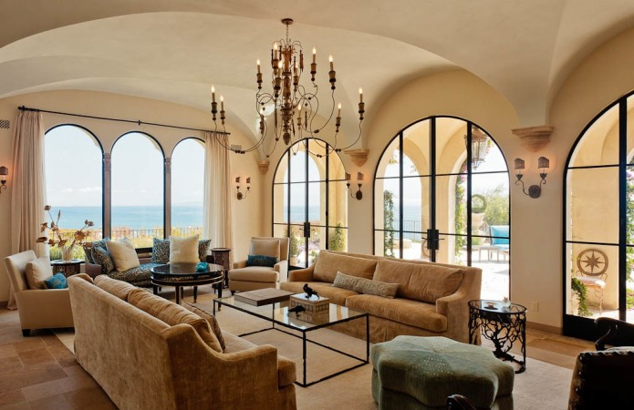 "Here, in the living room, as in the other principal rooms, the views to the Pacific Ocean are ""re-presented"" and rediscovered; framed with large arched openings, and custom steel French doors."