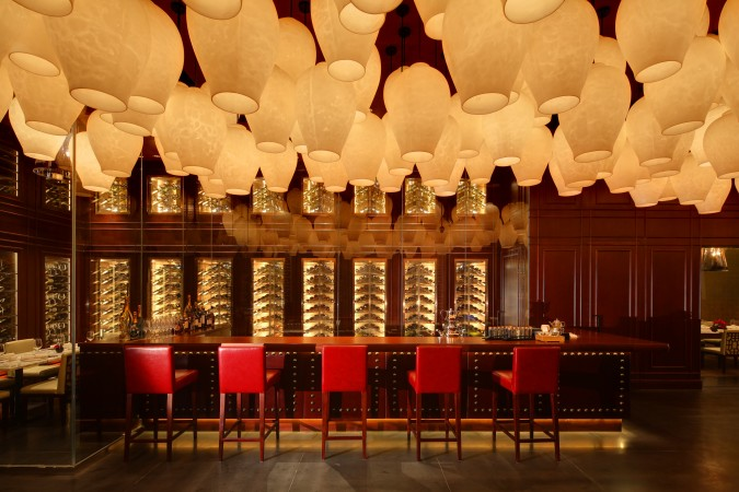 Hundreds of internally lit lanterns hang from the ceiling of the bar, while Mahogany and rich leathers help create a romantic and sophisticated vibe. Young Yi Ting restaurant at the Mandarin Oriental, Shanghai.