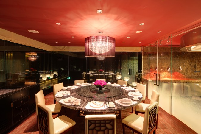 Each private dining area is surrounded by one way mirror allowing guests to see out, while being protected from outside viewers. Each private dining room also has its own custom color palate at the Young Yi Ting restaurant at the Mandarin Oriental, Shanghai.