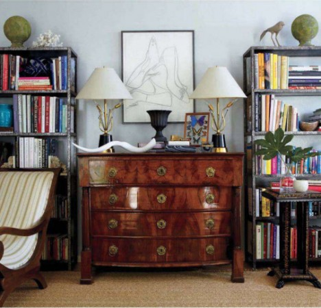A Biedermeier dresser in a West Hollywood home is topped with 1950s vintage lamps. Above it hangs an Andy Warhol shoe drawing.
