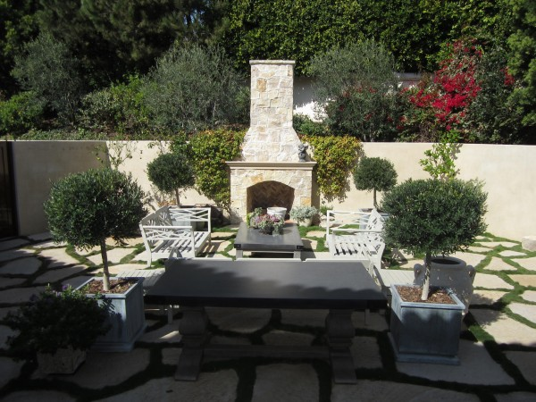 An outdoor seating area, adjacent to a Malibu house. The fireplace 3 types, of stone, Santa Barbara sandstone, Montana gold and Utah buff, which lend it a variety of colors.