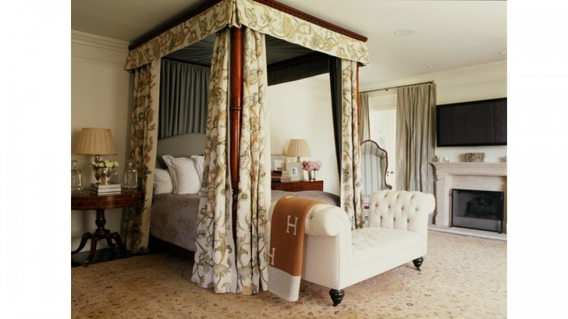 For the home of a Beverly Hills fashion designer the bedroom was designed to be sophisticated and elegant. Walls are covered with silk damask, there is a vintage Agra carpet and Chelsea textiles abound.