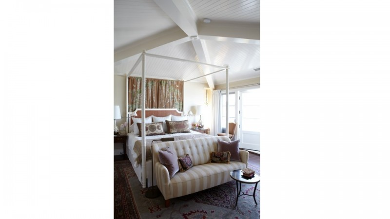 A bedroom in a Newport Beach house, on Lido Island. Sumptuous fabrics and a vintage carpet make the space feel elegant but warm and comfortable.
