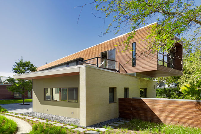This 5800-square-foot home in Palo Alto, Ca. was designed to adhere to the family's sustainability concerns. The lower part of the house has primary walls of highly crafted rammed earth made with soil excavated from the site. Between the upper and lower floors an 18-inch ribbon of glass allows soft light and allows the upper level to appear as though floating.