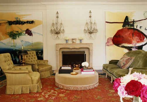 A important 1930's Beverly Hills house is made stunning, chic and sophisticated, by the talented hand of the designer who mixed 2 large Julian Schnabel paintings with a 1940s, Maison Jansen sofa, an antique carpet, and a pair of crystal wall  sconces from the same period as the house.
