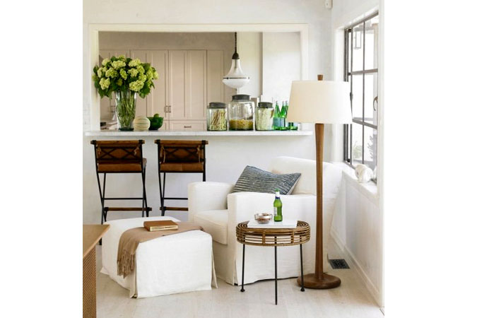 The open airy atmosphere in this room is complimented by the green and brown accents that lend it warmth and comfort.