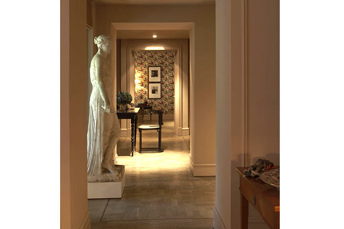 In an entry hall stands a 19th-century French plaster statue. Down the hallway is a small work area with a desk by Marcel Wanders and a chair by Viennese architect Josef Hoffman. Now that's an eclectic mix.