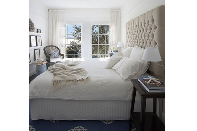 A palette for a beach house was restricted to black stained oak floors, white planked walls &amp; battened ceilings and a generous dose of white linen in the form of slip covers &amp; sheer curtains. Blue &amp; white predominates in china &amp; fabric patterns as well as classic woven rugs from Madeline Weinrib in New York.<br />