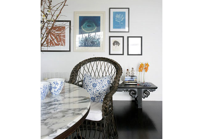 Marble and wicker -- an unexpected pairing- in a seaside home.