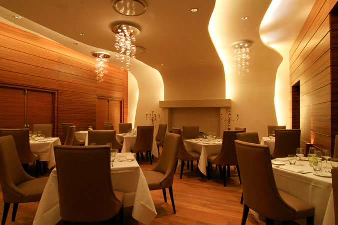 "The restaurant's true focal point is the large ""Colombino"" stone fireplace, in the Exedra Hotel, in Nice, France."