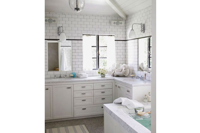 The brick-style tiling compliments the marble accents of the bathroom.