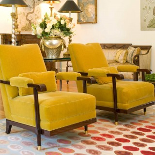 mustard tone velvet chairs, vibrant red carpet
