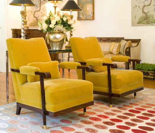 The Donatello chair in polished Mahogany with antique brass sabots and upholstered in mustard mohair fabric.​​
