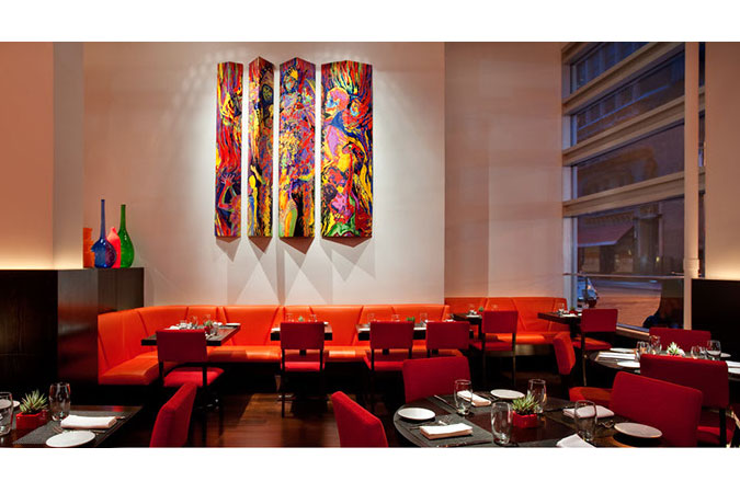 Orange and red provide a vivid and expressive color palette for a Latin restaurant concept in NYC.
