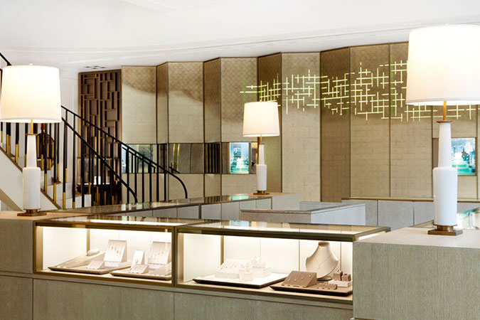 For a Tiffany store in Shanghai gold shimmering tones were used to underscore the sense of luxury of the brand&#039;s long tradition. Here, a wall that appears like a screen, uses the tradition of eglomise- -reverse painting on glass, in gold leaf to create a pattern.<br />