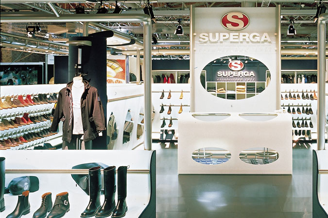 Superga the rubber shoe brand made in Italy. Here the Milan store, using very industrial materials for the design, suits the product and enhances the branding.