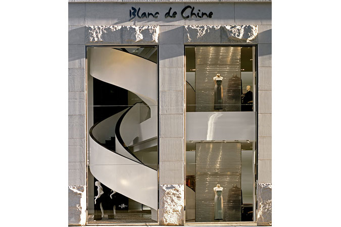 The dramatic stair way faces the street, becoming an important element in the facade,  in New York City. This chic and elegant store was done for the brand Blanc de Chine, by a New York based design and architecture firm.