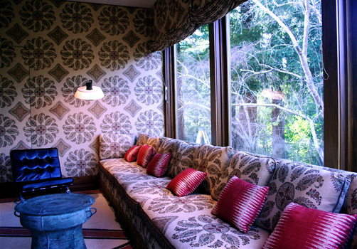 For an adventurous well traveled client living in a 1958,  Joseph Eshrerick house, in Woodside, Ca. the designer used Indian inspired patterned fabric and bold seating to enliven a large reception room.