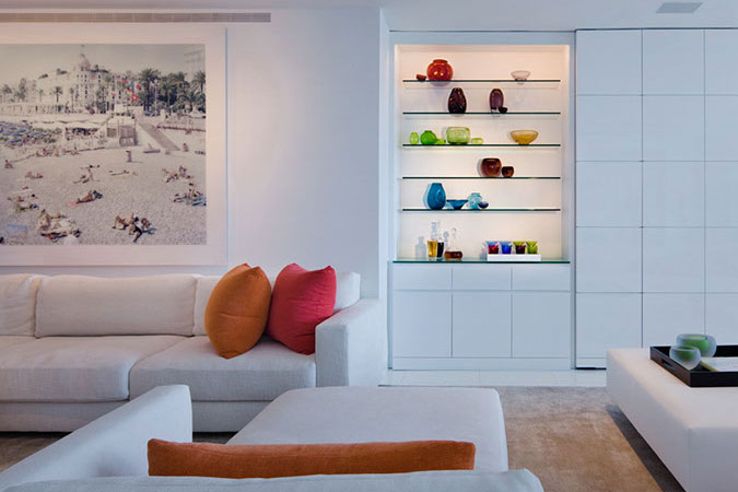 This cool white loft in Miami has been accented with hot tropical colors.