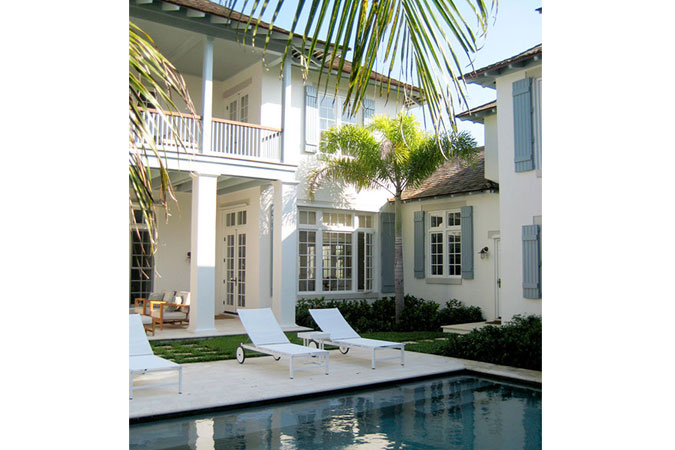 There's something timeless about  glamorous traditional luxury in Florida with a modern pool.