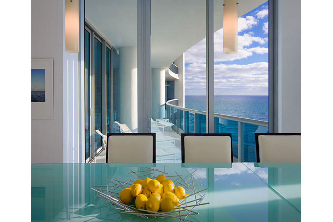 Blue:  sky, balcony, water,  even the glass topped table. What else is there to say.. perfection. Just add sunshine.