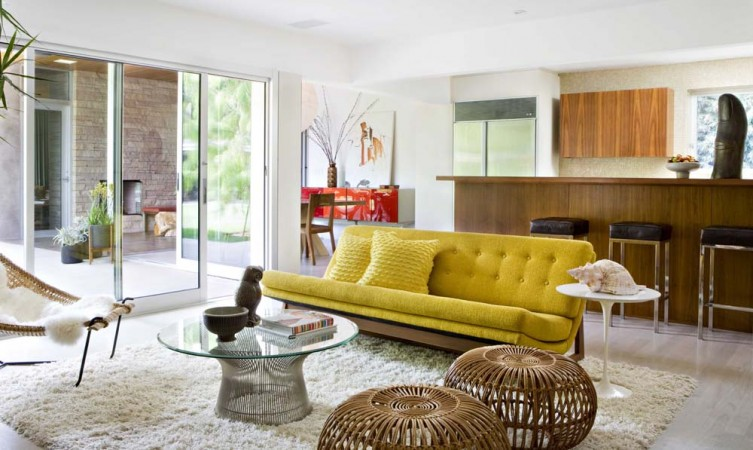 The playful and organic furnishings in this mid-century modern house in Brentwood, California set the stage for a young family's love of nature and color.