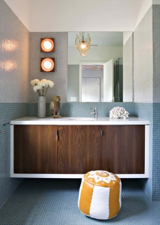 Mosaic tile, warm walnut and a pair of vintage German ceramic sconces set the stage for a young girl's bathroom.