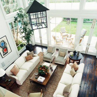 dark wood floors white upholstery double height ceiling, natural light
