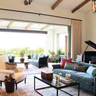 beamed ceiling open to garden inside outside blue sofa patio furniture