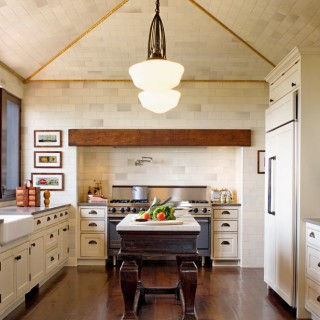 floor to celing tile kitchen Pacific Palisades center island antique table