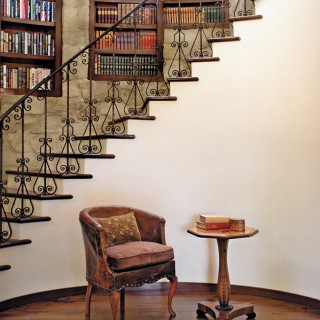curved stone wall staircase books built into stone