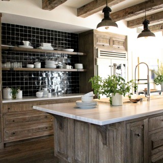 rustic beams black tile white stone counter tops beams
