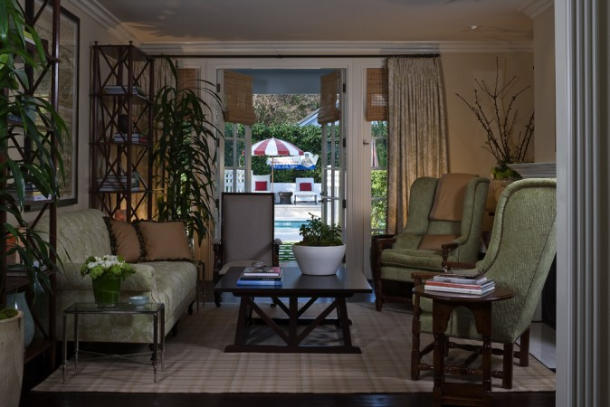 The rich furniture pieces provide comfort while the opaque curtains creates a division of spaces and shade to the indoor space during the sunniest parts of the day. The French doors lead to the pool.
