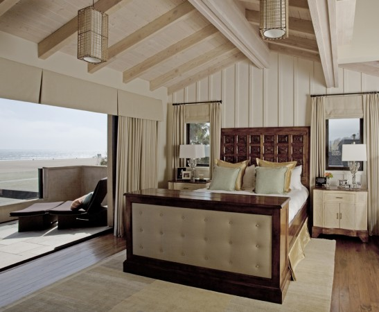 This home is a quiet coastal retreat south of Los Angeles, where the bedroom opens to the Pacific Ocean. The headboard has been fashioned from an antique Spanish door.