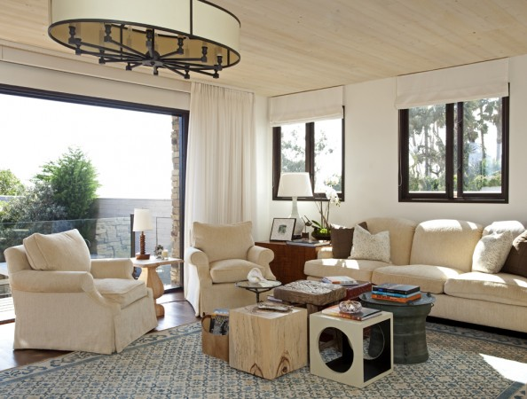 Bleached wood and a neutral color palette add to the calm look required for a true seaside experience.