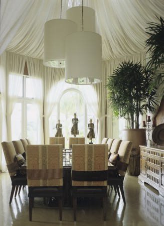 The double height dining room was tented with sheer linen to create a dreamy fantasy with an Asian flair.