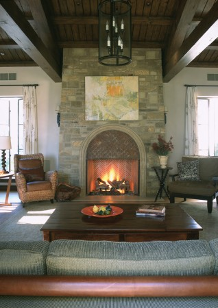 The casual living room of this space includes a stone fireplace created from fieldstone found on the property.