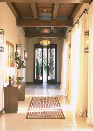 An entry hall to a modern California ranch. Custom made wrought iron and lighting unify the space.