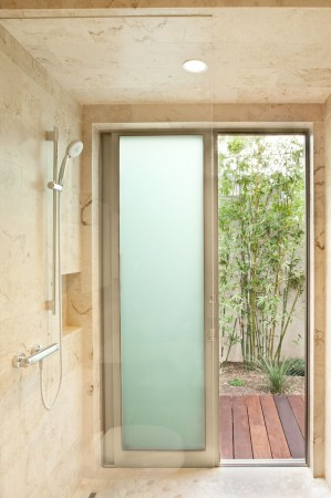 Sandblasted glass, stone and bringing in elements of nature are a winning combination in a shower in a Montecito, Ca. home.