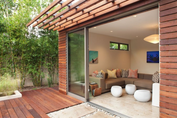A pool cabana is made of Ipe wood, glass doors, and a steel shade structure. The exquisite precision detailing of this LEED certified house in Montecito, Ca. allows for seamless indoor/outdoor living.<br />